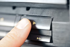 Finger pushing play button. On a vintage audio cassette deck Stock Photography