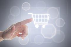 Finger pushing shopping cart symbol Stock Photo