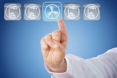 Finger Pushing Wind Power Button Over Blue Ground Royalty Free Stock Photos