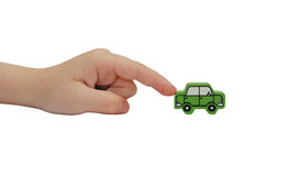 Finger pushing on a wooden car Royalty Free Stock Image