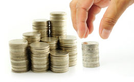 Finger put coin on coin-stack Stock Photography