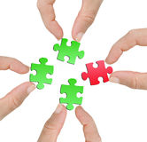 Finger with puzzle Stock Photos