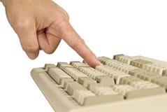Finger que pulsa la tecla de teclado aislada en blanco Imagen de archivo libre de regalías