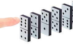 Finger ready to push domino pieces Royalty Free Stock Image