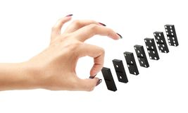Finger ready to push over dominoes Royalty Free Stock Image