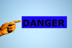 Finger with rectangular label DANGER Royalty Free Stock Photos