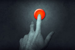 Finger on Red Button Stock Image