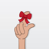 Finger Reminder. Finger with tied red bow as a reminder Stock Image