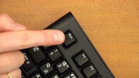 Finger repeatedly presses the corner button Esc