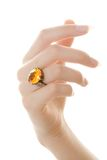 Finger ring. Close up of yellow/orange ring on hand isolated on white stock photo