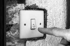 Finger ringing a door bell Stock Image