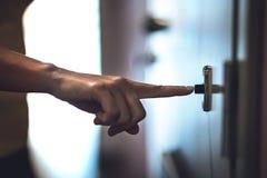 Finger ringing doorbell. Hand pushing door bell. royalty free stock photo