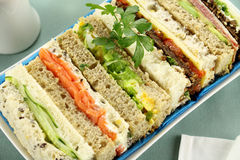 Finger Sandwiches. Freshly prepared assorted sandwiches cut without crusts Royalty Free Stock Image
