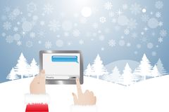 Finger of Santa Claus chatting in tablet. View of finger of Santa Claus chatting in tablet.  Winter snowy  landscape is in the background Stock Photo
