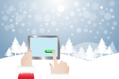 Finger of Santa Claus touching button Subscribe in winter lands. View of finger of Santa Claus touching green button Subscribe in tablet.  Winter snowy Stock Images