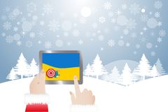 Finger of Santa Claus touching tablet with picture of summer be. View of finger of Santa Claus touching tablet with picture of top view of summer beach. Winter Stock Photography