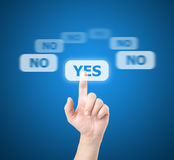 Finger selects touchscreen - YES royalty free stock images