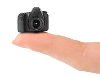 Finger and small camera Stock Photo