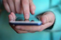 Finger on an Smart Phone Exploring Data. Finger on a smart phone exploring data Royalty Free Stock Photo