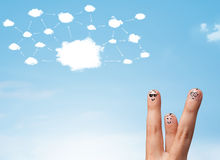Finger smiley with cloud network system. Finger smiley faces on hand with cloud network system Royalty Free Stock Photos