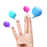Finger smileys with colorful speech bubbles Stock Photos