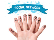 Finger smileys with social network sign Royalty Free Stock Images