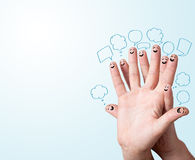 Finger smileys with speech bubbles. stock photography