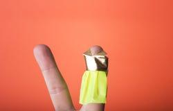 Finger som bär en klänning. Du kan dra vad du önskar Royaltyfri Bild