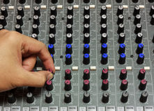 Finger someone sound tuning mixer. Stock Images