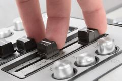 Finger sound control-2. Fingesr of a sound operator Stock Images
