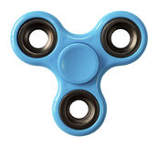 Finger Spinner Blue. Finger spinner made of blue plastic on an isolated white background royalty free stock photo