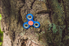 Finger spinner on the playground. Blurred background.  stock photography
