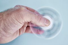 Finger Spinner. A studio photo of a finger spinner stock photos