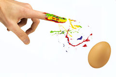 Finger sprinkle paint over the blank egg Royalty Free Stock Images