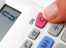Finger switching on calculator Royalty Free Stock Photos