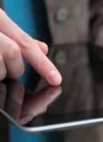 Finger on tablet computer screen Stock Photos