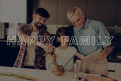 Finger on Tablet. Dinner. Happy Family.Salad. Boy. Finger on Tablet. Dinner. Happy Family. Salad. Boy in T-shirt. Together at Home. Father in Red Shirt royalty free stock photography