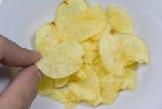 Finger take fire potato chip Royalty Free Stock Photos