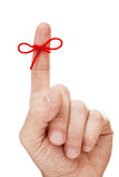 Finger with tied bow Royalty Free Stock Image