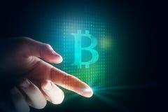 Finger tip with bitcoin Stock Photos