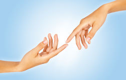 Finger tips reaching out each other, close-up Royalty Free Stock Images