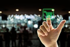 Finger touch application for online shopping. Point finger touch shopping application green light on dark bokeh background Royalty Free Stock Photos