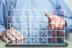 Finger touch the calendar. Business concept Stock Photo