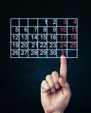 Finger touch the calendar. Business concept Royalty Free Stock Images