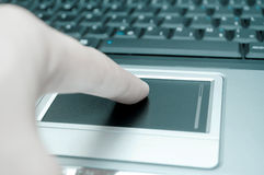 Finger on the touch-pad Stock Image