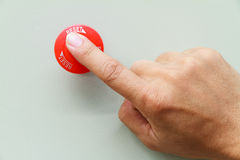 Finger touch on red emergency stop switch Stock Photo