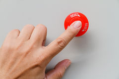 Finger touch on red emergency stop switch and reset Royalty Free Stock Image