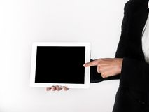 Finger on the touch screen shows Royalty Free Stock Image