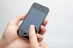 Finger touch touchscreen phone. Finger touching iphone on white background Royalty Free Stock Photo