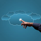 Finger touches the clouds Stock Photography